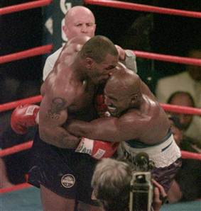 Mike Tyson, left, bites into the ear of Evander Holyfield on June 28, 1997.