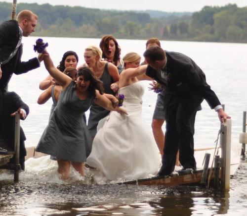 My cousin's entire Bridal Party sank into a lake this weekend. Awesome picture....