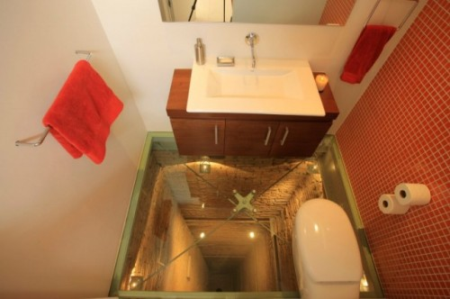 powder room and its glass floor set atop an unused 15 story lift shaft!