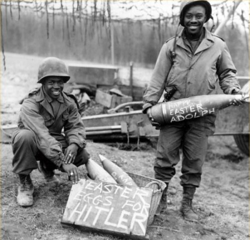 """Easter morning, T/5 William E. Thomas...and Pfc. Joseph Jackson...will roll specially prepared eggs on Hitler's lawn."" March 10, 1945."
