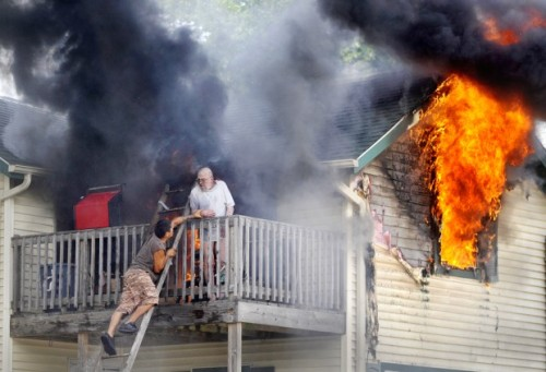 firefighters help rescue man from burning balcony
