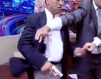 A heated television debate between a Jordanian member of parliament and a local activist this week led to the parliamentarian pulling a gun on the activist in front of the cameras.