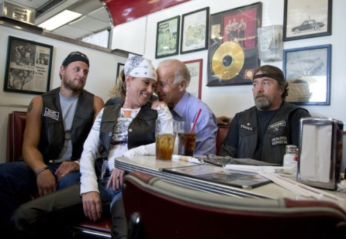 A lady biker sits on Biden's lap today at Cruisers Diner in Seaman, Ohio. via the AP