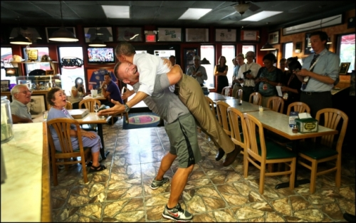 Pizza shop owner bear hugs President Obama