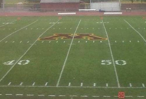 Ski-U-Mah! U of MN Crookston football paints logo at 45-yard line