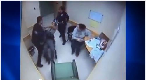 Duluth cop caught on tape punching a guy in a wheelchair
