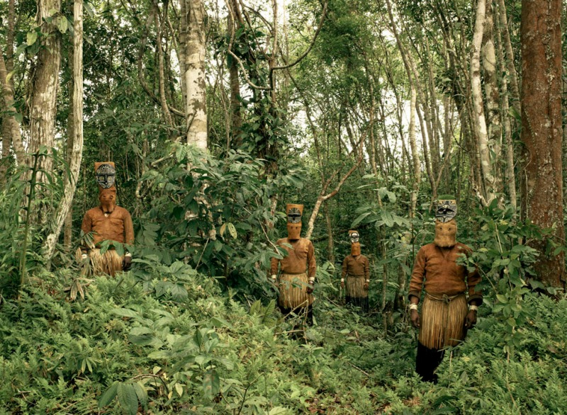 Guardians of the Forest: Deep in the Colombian Amazon, Yucuna indians stand dressed in traditional tribal attire for the Baile del Muñeco, or puppet dance, a celebration of the abundance of the Chontaduro fruit. While traditional indigenous customs are fast being lost throughout the Amazon jungle, here, far down the Caqueta river and few miles from the Brazilian border, traditions are still very much intact. The costumes are still made entirely from natural materials, predominantly tree bark, during this three day festival. (© Piers Calvert/National Geographic Photo Contest)