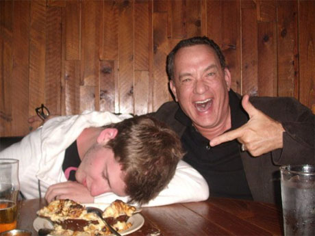 Photos of actor Tom Hanks posing with a fan pretending to be drunk have inspired a flood of celebrity-encounter stories on Reddit. (imgur.com)